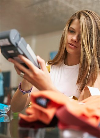 Teenaged Girl Paying for Items In Store Stock Photo - Rights-Managed, Code: 700-00695597
