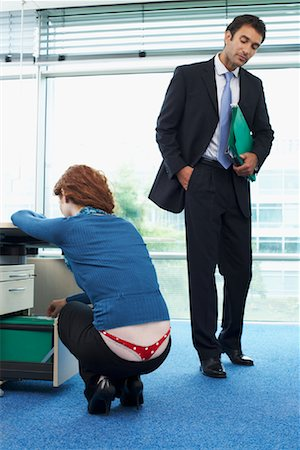 Man Staring at Co-Worker's Underwear Stock Photo - Rights-Managed, Code: 700-00748545