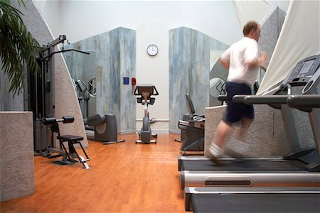 fat man exercising - Man Using Treadmill Stock Photo - Rights-Managed, Code: 700-00767947
