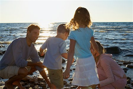 Family on Rocky Shoreline Stock Photo - Rights-Managed, Code: 700-00768219