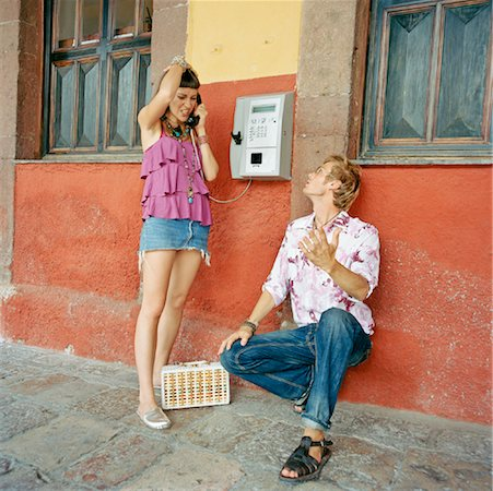 Couple Using Pay Phone Stock Photo - Rights-Managed, Code: 700-00768485