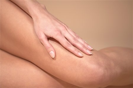 Close-up of Woman's Hand on Leg Stock Photo - Rights-Managed, Code: 700-00768819