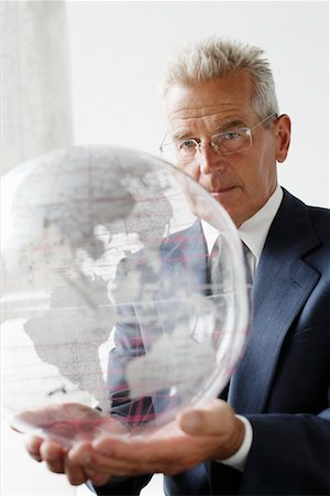 Mature Man Holding Globe Stock Photo - Rights-Managed, Code: 700-00782378