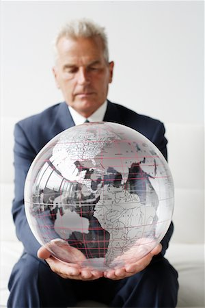 Mature Man Holding Globe Stock Photo - Rights-Managed, Code: 700-00782379