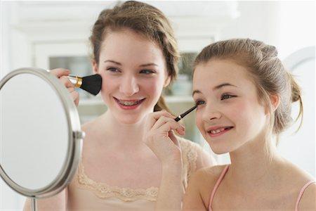 Girls Applying Make-Up Stock Photo - Rights-Managed, Code: 700-00864951