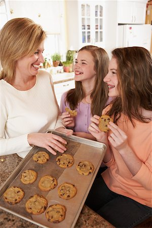 Girls Eating Cookies with Mother Stock Photo - Rights-Managed, Code: 700-00864984