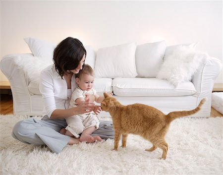 shy baby - Mother and Son with Cat in Living Room Stock Photo - Rights-Managed, Code: 700-00865705