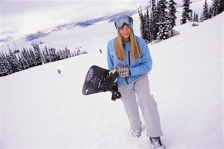 Woman Holding Snowboard Stock Photo - Rights-Managed, Code: 700-00866678
