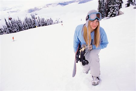 Woman Carrying Snowboard Stock Photo - Rights-Managed, Code: 700-00866679
