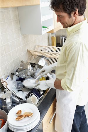 Man Washing Dishes Stock Photo - Rights-Managed, Code: 700-00909722