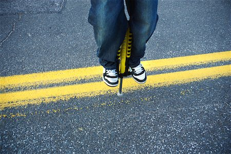 Close Up of Boy Jumping On a Pogo Stick Stock Photo - Rights-Managed, Code: 700-00917678