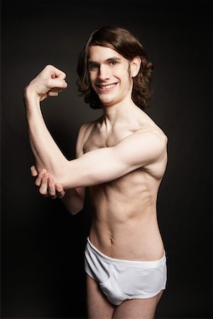 skinny man muscle pose - Man Flexing Muscles Stock Photo - Rights-Managed, Code: 700-00910164