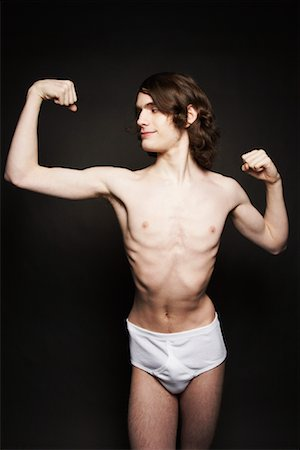 skinny man muscle pose - Man Flexing Muscles Stock Photo - Rights-Managed, Code: 700-00910161