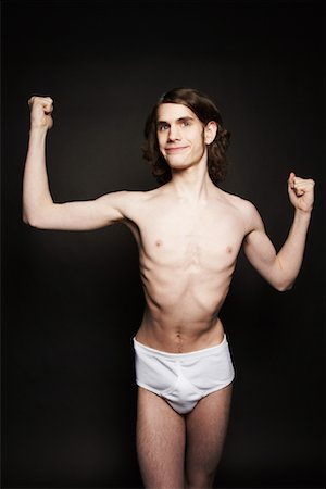 skinny man muscle pose - Man Flexing Muscles Stock Photo - Rights-Managed, Code: 700-00910162