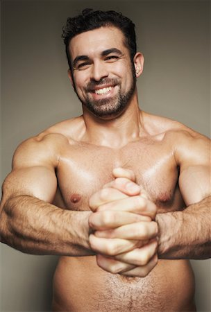 Man Flexing Muscles Stock Photo - Rights-Managed, Code: 700-00910238