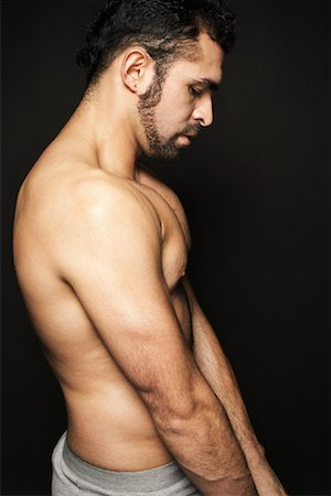 Man Flexing Muscles Stock Photo - Rights-Managed, Code: 700-00910252