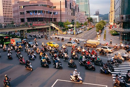 Mopeds Crossing Street, Taipei, Taiwan Stock Photo - Rights-Managed, Code: 700-00910493