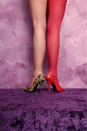 stocking feet - Woman With Mismatched Shoes and Stockings Stock Photo - Rights-Managed, Code: 700-00911388