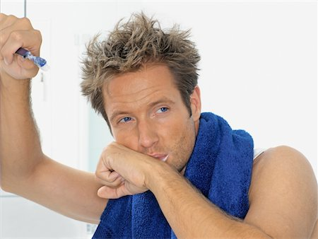 Man Brushing Teeth Stock Photo - Rights-Managed, Code: 700-00911433