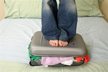 female 16 year old feet - Woman Standing on Suitcase Stock Photo - Rights-Managed, Code: 700-00911723