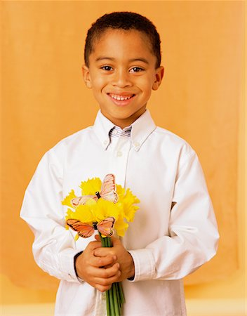 Child Holding Flowers Stock Photo - Rights-Managed, Code: 700-00934159