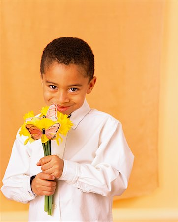 Child Holding Flowers Stock Photo - Rights-Managed, Code: 700-00934160