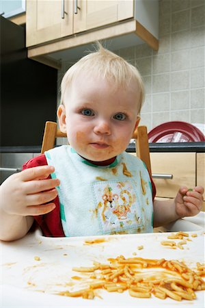 Portrait of Boy Covered in Spaghetti Sauce Stock Photo - Rights-Managed, Code: 700-00934488