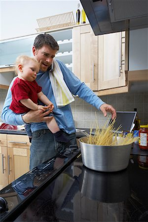 Father and Son Making Spaghetti Stock Photo - Rights-Managed, Code: 700-00934489