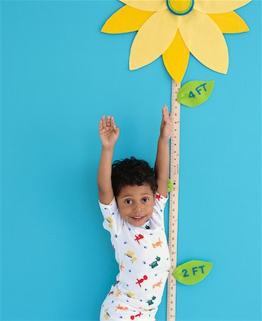 Portrait of Boy by Growth Chart Stock Photo - Rights-Managed, Code: 700-00984289