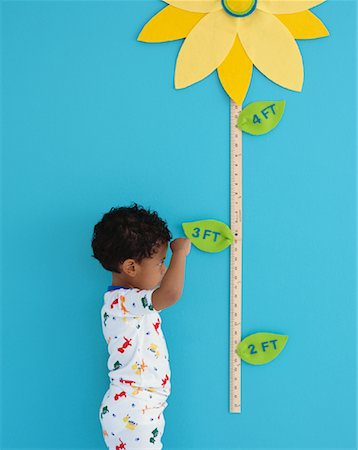 Portrait of Boy by Growth Chart Stock Photo - Rights-Managed, Code: 700-00984290