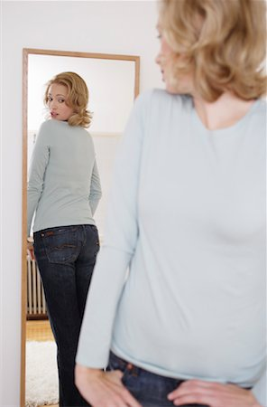 Woman Looking in Mirror Stock Photo - Rights-Managed, Code: 700-00984306