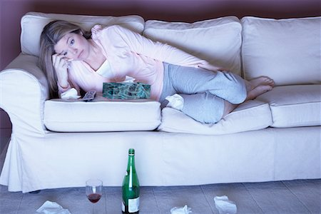 Woman with Red Wine Crying on Sofa Stock Photo - Rights-Managed, Code: 700-01015065