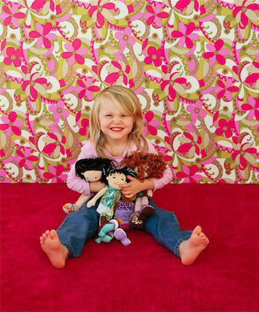 Portrait of Girl With Dolls Stock Photo - Rights-Managed, Code: 700-01015317
