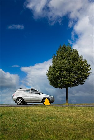Clamped Car Wrapped in Plastic Wrap Stock Photo - Rights-Managed, Code: 700-01015436