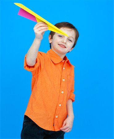 Boy Playing With Paper Airplane Stock Photo - Rights-Managed, Code: 700-01037176