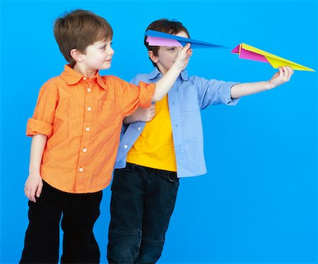 Boys Throwing Paper Airplanes Stock Photo - Rights-Managed, Code: 700-01037177