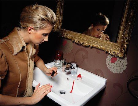Woman Applying Nail Polish Stock Photo - Rights-Managed, Code: 700-01037189