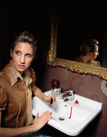 Woman Applying Nail Polish Stock Photo - Rights-Managed, Code: 700-01037190