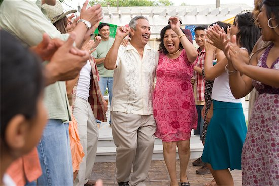 Couple Dancing at Family Gathering Stock Photo - Premium Rights-Managed, Artist: Tim Mantoani, Image code: 700-01041252