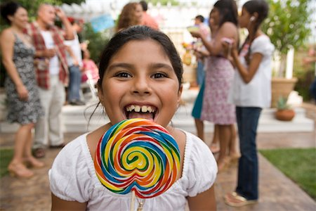 Girl with Lollipop at Family Gathering Stock Photo - Rights-Managed, Code: 700-01041298