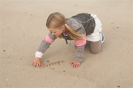 Girl Drawing in Sand Stock Photo - Rights-Managed, Code: 700-01042701