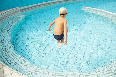 Boy Jumping into Swimming Pool Stock Photo - Rights-Managed, Code: 700-01072114