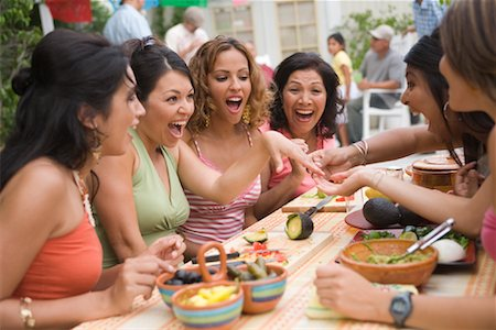 Woman Showing Engagement Ring to Friends at Party Stock Photo - Rights-Managed, Code: 700-01072567
