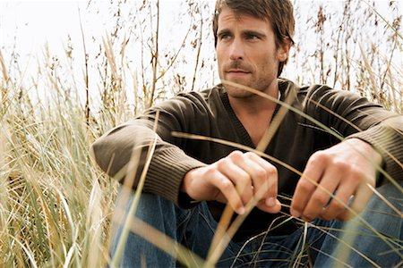 Portrait of Man Sitting in Long Grass Stock Photo - Rights-Managed, Code: 700-01082837