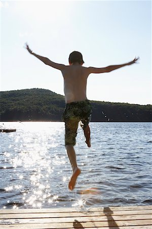 preteen  smile  one  alone - Boy Jumping Off Dock Stock Photo - Rights-Managed, Code: 700-01083425