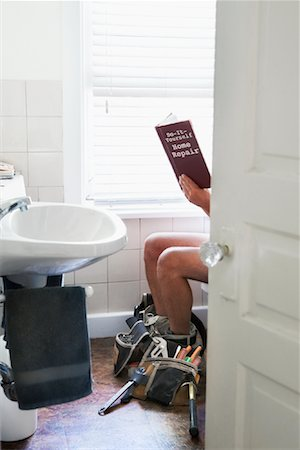 Man Sitting on Toilet Reading Stock Photo - Rights-Managed, Code: 700-01099830