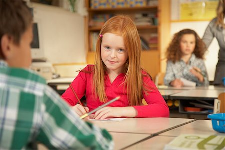 simsearch:600-01184690,k - Portrait of Girl Sitting at Desk in Classroom Stock Photo - Rights-Managed, Code: 700-01119803