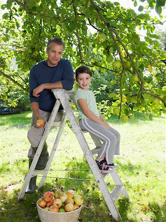 family apple orchard - Girl in Orchard Stock Photo - Rights-Managed, Code: 700-01119831