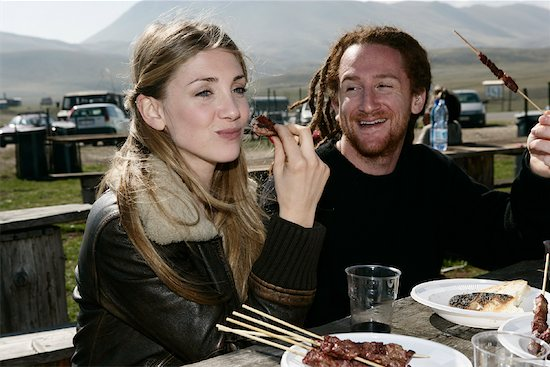 Couple Eating Outdoors Stock Photo - Premium Rights-Managed, Artist: Siephoto, Image code: 700-01112169