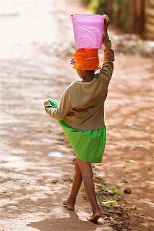 Girl Carrying Water, Ambalavao, Madagascar Stock Photo - Rights-Managed, Code: 700-01112681